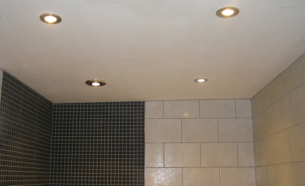 Four low energy spotlights (one including built in extractor fan) fitted